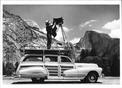 ANSEL ADAMS PHOTOGRAPHING IN YOSEMITE VALLEY (ON A WOODY STATION WAGON)