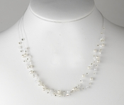 Silver plated necklace features white faux pearls, clear rhinestones and AB crystals Necklace 8363