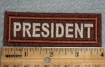 1661 L - President - Dark Brown Background - Embroidery Patch