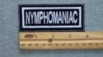 129 L - NYMPHOMANIAC - EMBROIDERY PATCH - WHITE