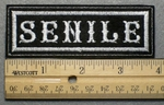 682 L - SENILE - Embroidery Patch - White Border White Letters