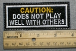 1040 L - CAUTION: DOES NOT PLAY WELL WITH OTHERS - Embroidery Patch - White Border Yellow and White Letters