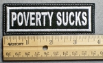 1107 L - POVERTY SUCKS - Embroidery Patch - White Border White Letters