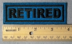 989 L - Retired Embroidery Patch - Blue Fabric Black Border Black Letters