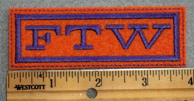 1602 L - FTW - Purple On Orange Background - Embroidery Patch
