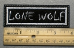 685 L - LONE WOLF - Embroidery Patch - White Border White Letters
