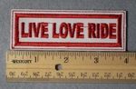 999 L - LIVE LOVE RIDE - Embroidery Patch - White Fabric Red Border Red Letters