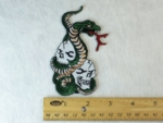 198 N - SNAKE WRAPPED AROUND SKULL PILE - EMBROIDERY PATCH