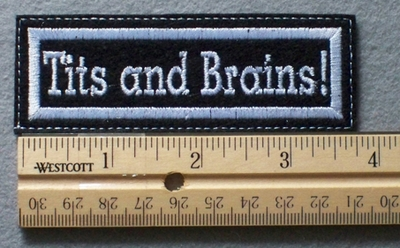 1077 L - Tits and Brains! - Embroidery Patch - White Border White Letters