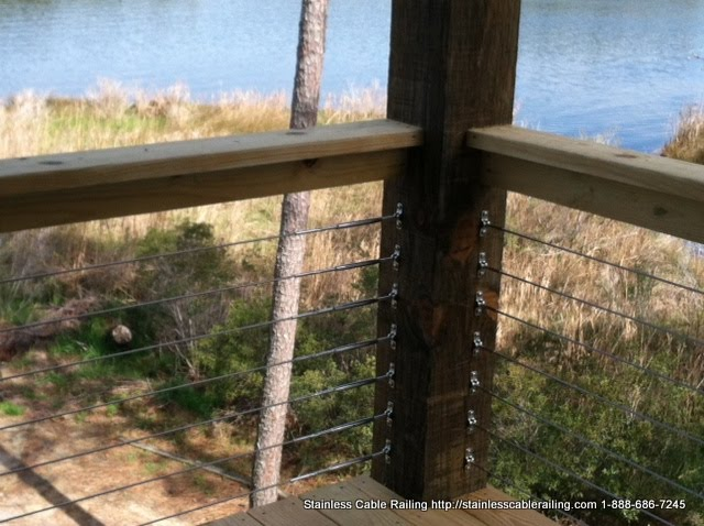 Cable railing system on a wood handrail and posts