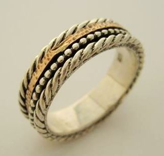 Delicate spinner ring silver and gold