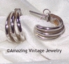 Small silvertone pierced earrings