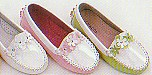 Lamour patent leather loafer with appliqued flowers and arch support.
