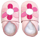 Bobux very soft pink leather shoes with a  petal flower and a suede sole to prevent slipping.