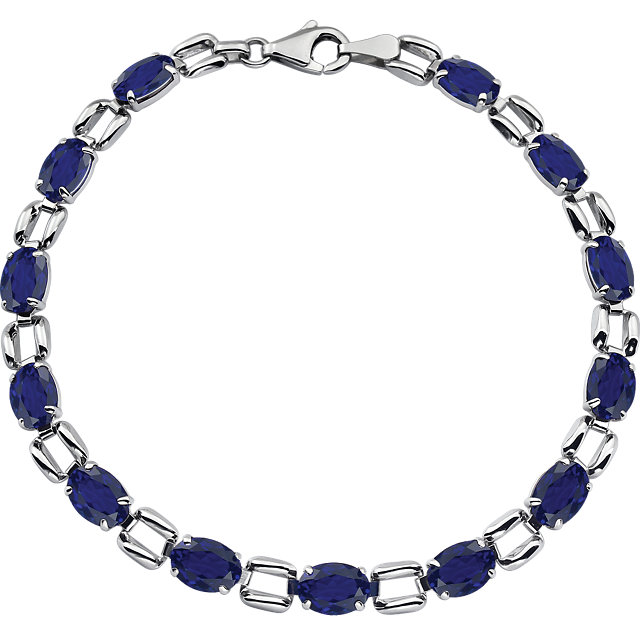 14KT White Gold 7x5mm Oval Blue Sapphire 7