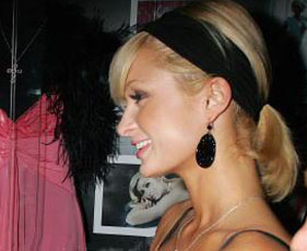 Paris Hilton in Tarina Tarantino Carved Disc Earrings