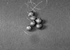 Pith Balls, Graphite Coated on Cord (pkg/6)