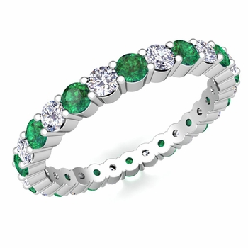Pave Diamond and Emerald Eternity Band in Platinum