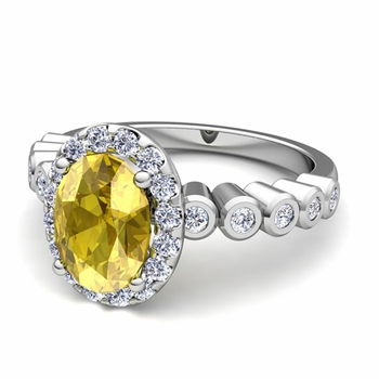 Bezel Set Diamond and Yellow Sapphire Halo Engagement Ring in Platinum, 7x5mm