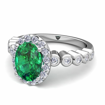 Bezel Set Diamond and Emerald Halo Engagement Ring in Platinum, 7x5mm