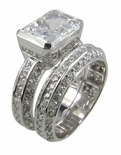 Luxotica Emerald Radiant Cut Cubic Zirconia Semi Bezel Set Pave Wedding Set