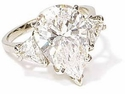 Pear with Trillions Cubic Zirconia Three Stone Engagement Rings