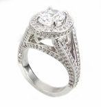 TomKat 4 Carat Oval Cubic Zirconia Pave Halo Split Shank Solitaire Engagement Ring