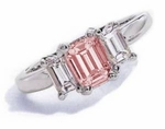 The Jen Pink Emerald Step Cut Cubic Zirconia Three Stone Solitaire Engagement Ring