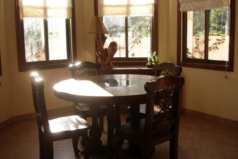Breakfast nook with Costa Rican style wood furniture