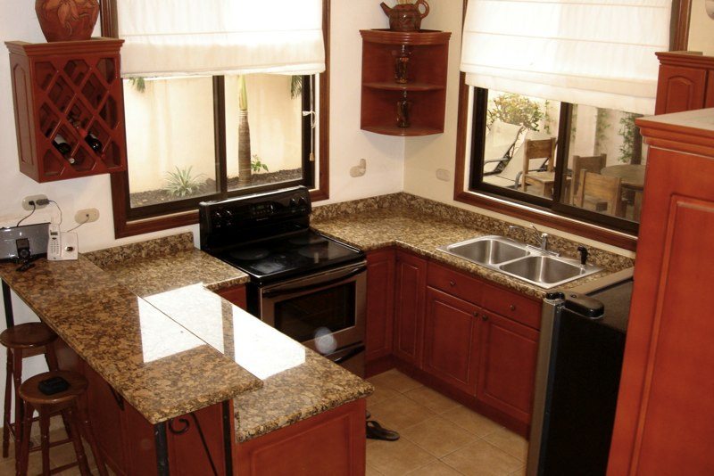 Kitchen has granite counters and stainless appliances.