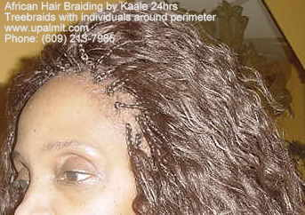 Treebraids with individuals around perimeter with wet and wavy 18 inches long hair.
