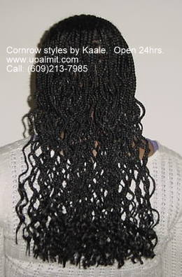 Cornrows braided in front with box braids in back, by Kaale.