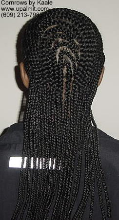 Medium cornrows with 180 degree wave design in back.
