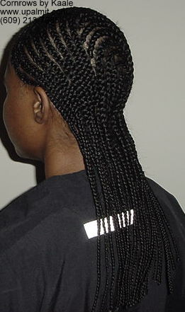 Medium cornrows with 180 degree design in back, left side view.