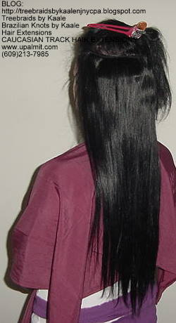Celebrity Track hair extensions- long straight hairLeft54.