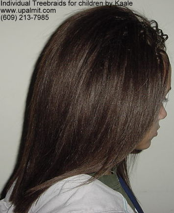Individual treebraids with straight human hair, side view.