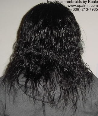 Individual treebraids with wet and wavy human hair, back view.