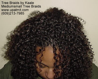 Summer, vacation, and beach Kinky curly Tree Braids- bending down.