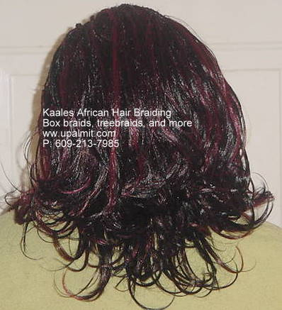 box braids with flip up ends are beautiful for the office by Kaales African Hair Braiding NJ.