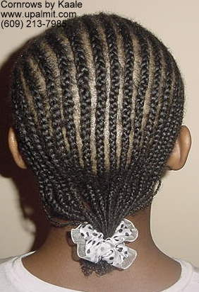 Cornrows styles with design on left side, back view.