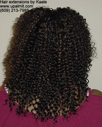 Hair extensions, hair weave, back view.