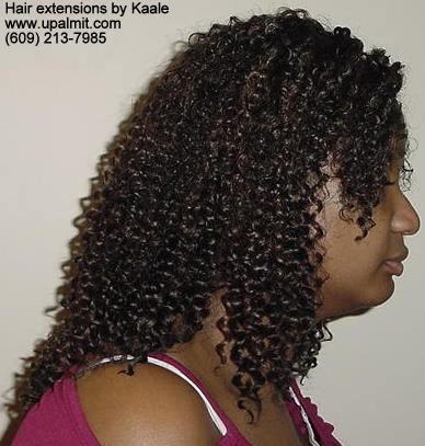 Hair extensions, hair weave, side view.
