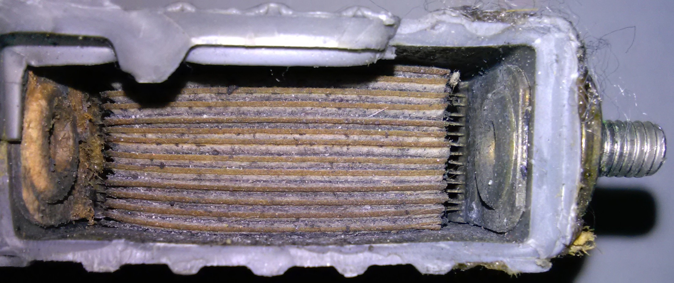 The Top Exploded Off This Battery And Is Ragged On Left Side Solid Vertical Lines Mark Divisions Between Each Cell