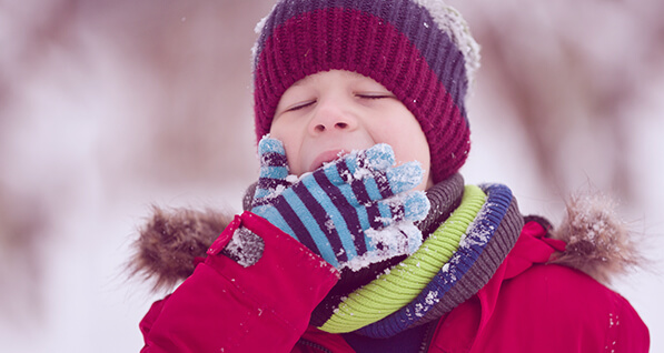 Child Eating Snow