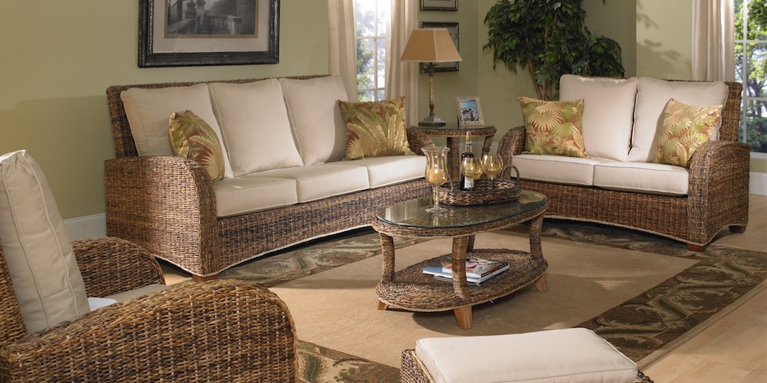 The St. Kitts Seagrass Coffee Table Has Style And Utility. It Has A  Generous Oval Shape With An Additional Shelf For Storage And A Glass Top.
