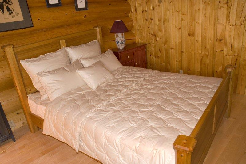 Crescent Moon comforter, mattress pad and pillow on bed