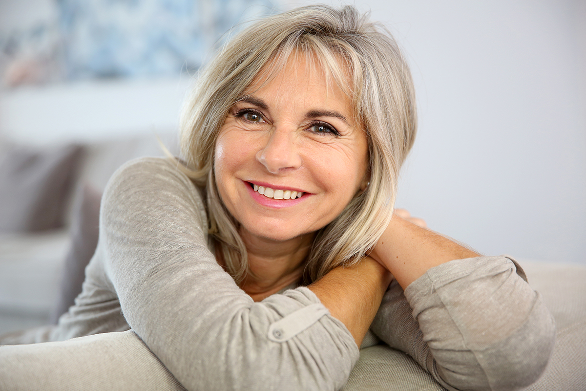 Smiling woman with aging skin