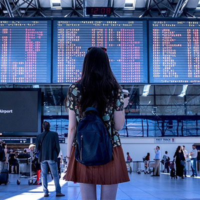 Woman standing in airport preparing to travel