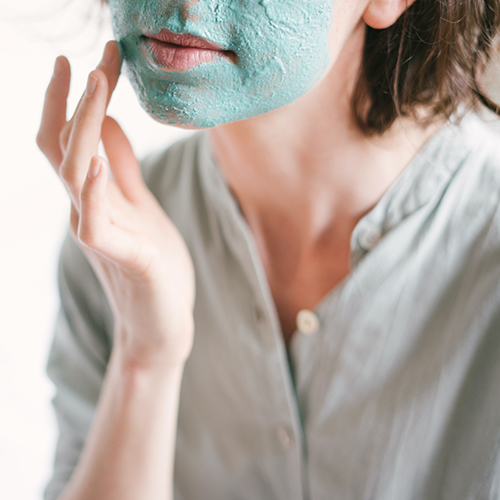 Applying face mask to combination skin