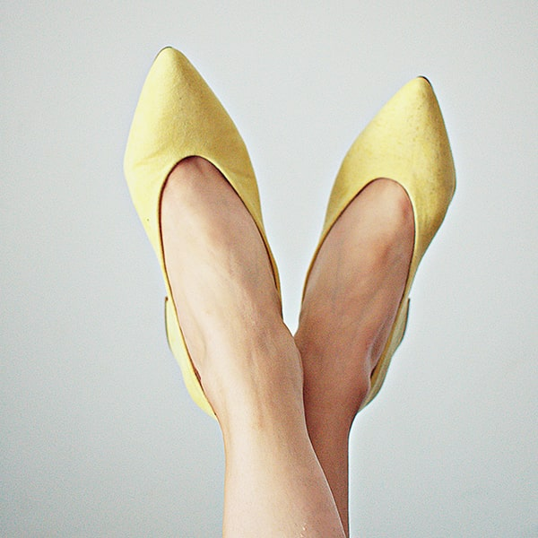 Feet in yellow spring time shoes